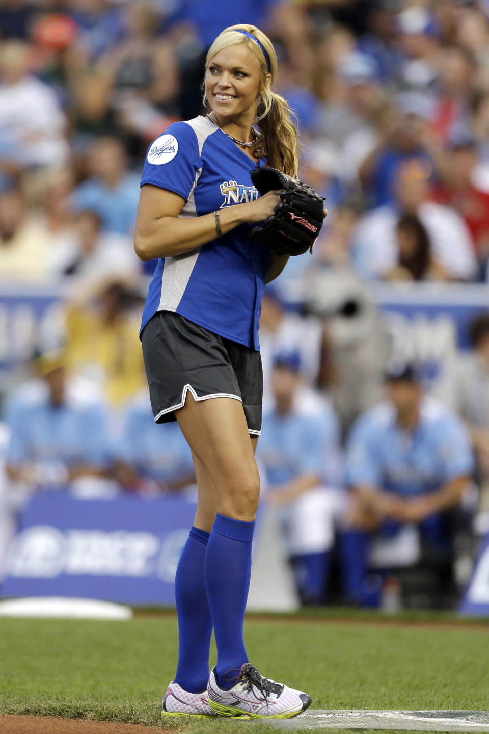Former softball player Jennie Finch prepares to pitch during the first inning of the MLB All-Star celebrity softball game, Sunday, July 8, 2012, in Kansas City, Mo. (AP Photo/Jeff Roberson)