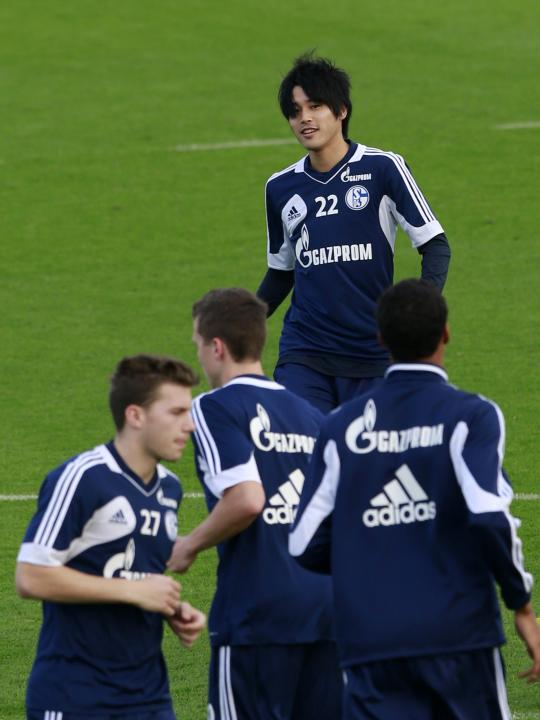 Schalke 04's Atsuto Uchida attends a training session at the Aspire Academy of Sports Excellence in Doha