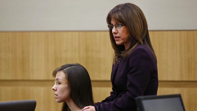 Defense attorney Jennifer Wilmott, right, places her hands on Jodi Arias and asks the jury not to give her the death penalty on Tuesday, May 21, 2013 during the penalty phase of her murder trial at Maricopa County Superior Court in Phoenix. Arias was convicted of first-degree murder in the stabbing and shooting to death of Travis Alexander in his suburban Phoenix home in June 2008. (AP Photo/The Arizona Republic, Rob Schumacher, Pool)