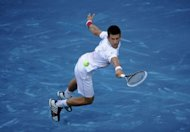 Serb Novak Djokovic returns a shot to Serb Janko Tipsarevic during their Madrid Masters tennis match in Madrid. Djokovic lost 7-6 (7/2), 6-3