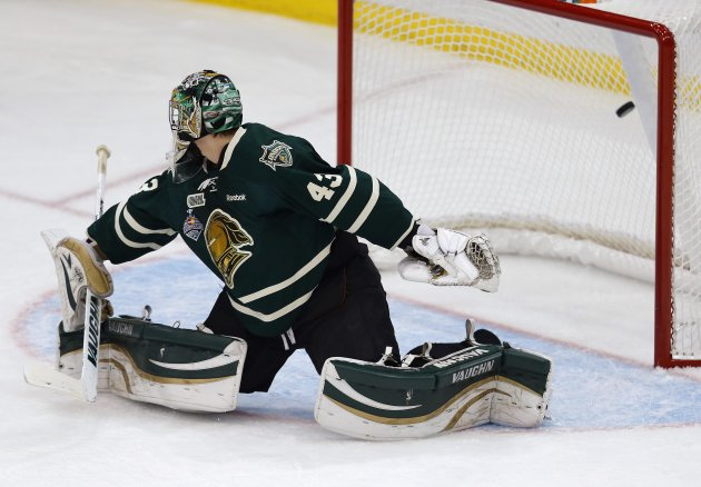 London Knights' Stolarz miss a puck for a goal by Halifax Mooseheads' Frk during the Memorial Cup Canadian Junior Hockey Championships in Saskatoon.