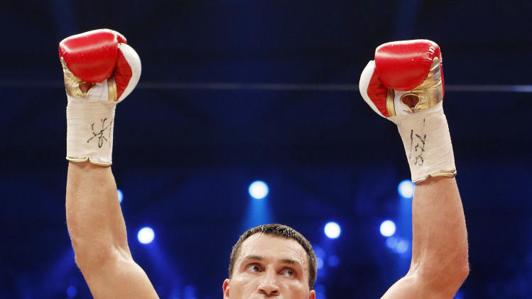 Ukranian boxer Wladimir Klitschko reacts after beating German-Italian Francesco Pianeta with knockout in a WBA-, IBF,- WBO- and IBO heavyweight world championship fight in Mannheim, Saturday, May 4, 2013.(AP Photo/Michael Probst)