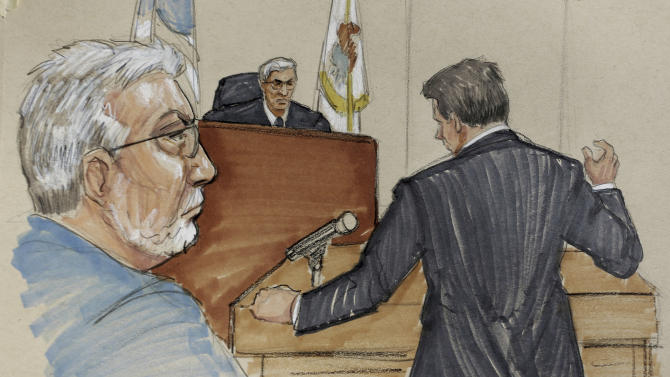 In this courtroom sketch, Drew Peterson, left, listens as his attorney John Heiderscheidt addresses Will County Judge Edward Burmila as Peterson's defense team sought to convince the judge to grant Peterson a new trial at the Will County Courthouse in Joliet, Ill., Wednesday, Feb. 20, 2013. Peterson's lawyers are asking for a retrial on grounds that his lead attorney at the 2012 trial that led to his conviction in the killing of his third wife, failed to adequately defend him.  (AP Photo/Tom Gianni)