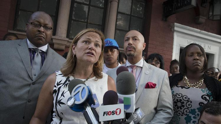 City Council Speaker Melissa Mark-Viverito, center left, speaks to the media during a vigil demanding justice for Eric Garner, a Staten Island man who died while being arrested by New York City police, Tuesday, July 22, 2014, in New York. Demonstrators gathered at a park Tuesday, near where police attempted to arrest Garner, 43, on suspicion of selling untaxed cigarettes. (AP Photo/John Minchillo)