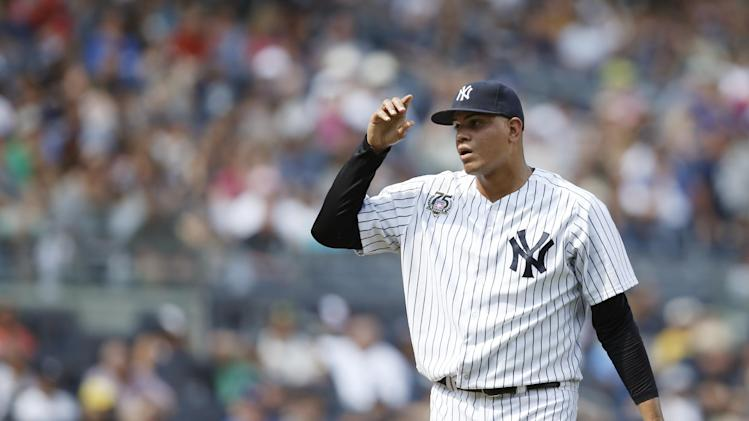 New York Yankees relief pitcher Dellin Betances (68) reacts after committing a throwing error trying to put out Toronto Blue Jays center fielder Colby Rasmus at first base in the eighth inning of a baseball game at Yankee Stadium in New York, Sunday, July 27, 2014. (AP Photo/Kathy Willens)