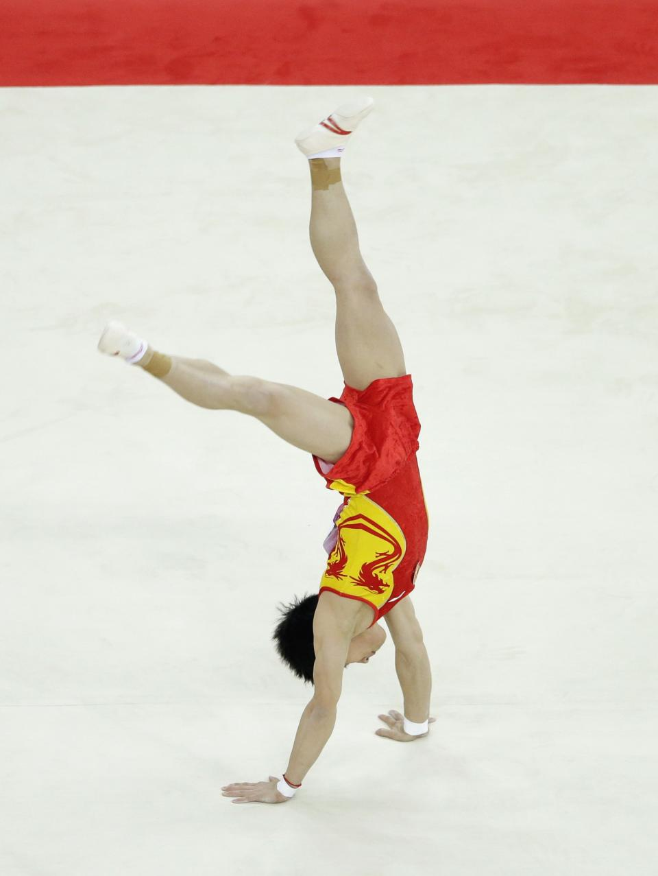 Chinese gymnast Zou Kai performs during the artistic gymnastics men's floor exercise final at the 2012 Summer Olympics, Sunday, Aug. 5, 2012, in London. (AP Photo/Gregory Bull)