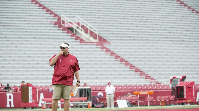 Arkansas head coach Bret Bielema blows his whistle to begin a preseason NCAA college football practice at Donald W. Reynolds Razorback Stadium in Fayetteville, Ark., Saturday, Aug. 16, 2014