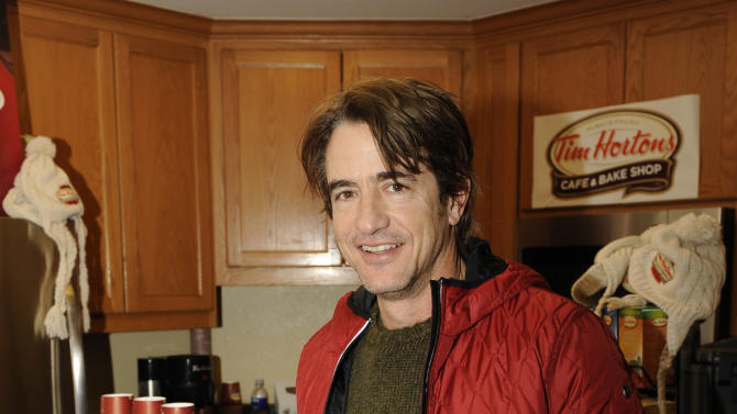 Actor Dermot Mulroney drinks Tim Hortons cafe & bake shop coffee at the Fender Music lodge during the Sundance Film Festival on Monday, Jan. 21, 2013, in Park City, Utah. (Photo by Jack Dempsey/Invision for Fender/AP Images)