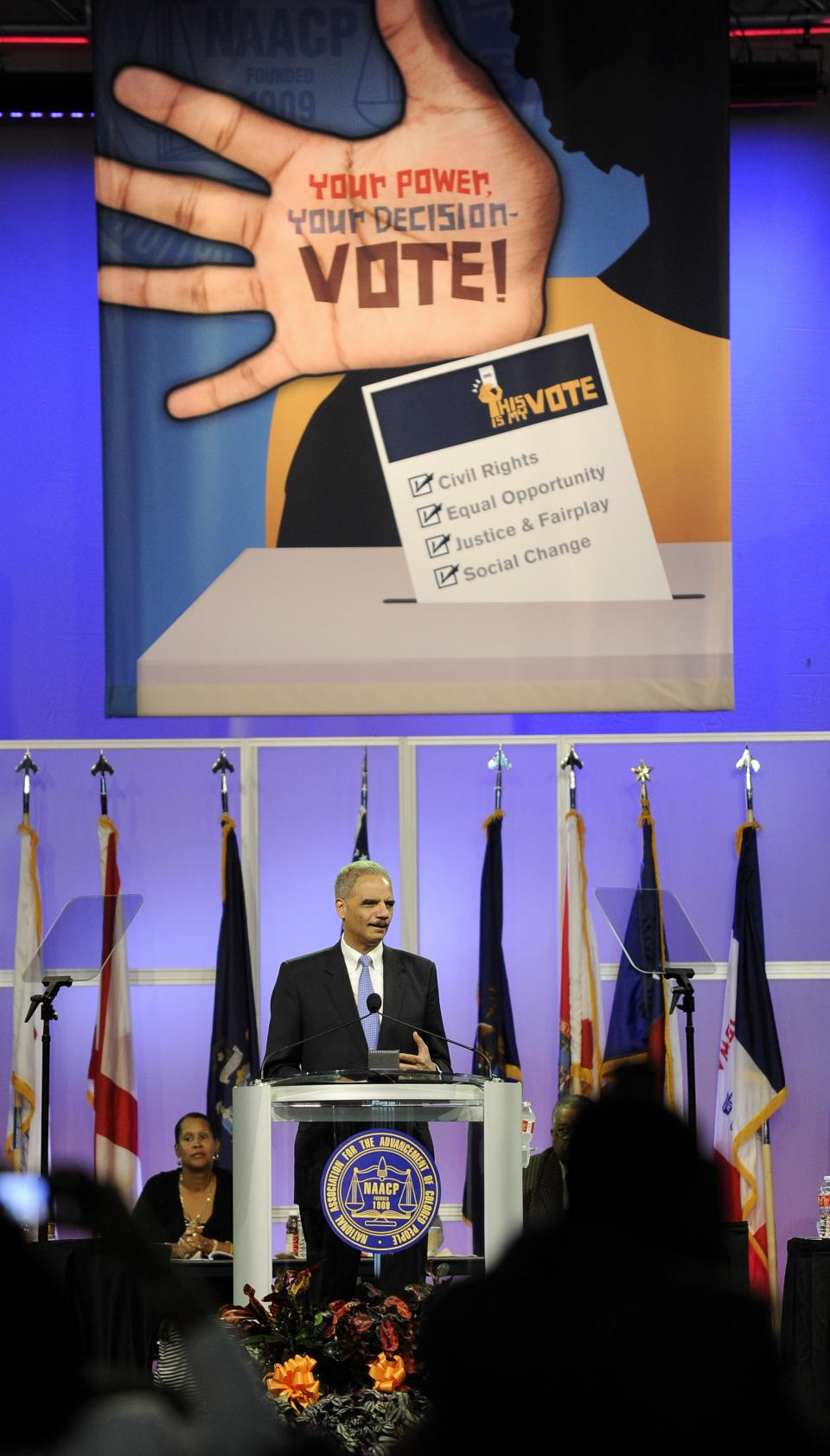 U.S. Attorney General Eric Holder speaks at the NAACP annual convention Tuesday, July 10, 2012, in Houston. Holder says he opposes a new photo ID requirement in Texas elections because it would be harmful to minority voters. (AP Photo/Pat Sullivan)