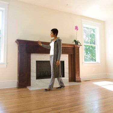 Woman-admiring-fireplace-in-her-new-home_web