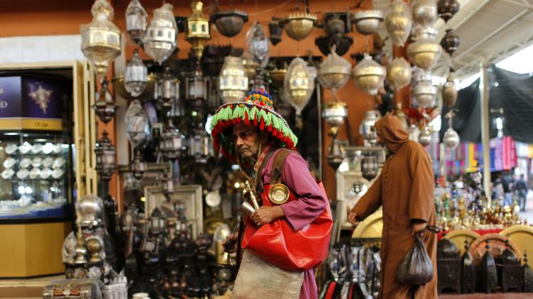 A Moroccan man wearing a traditional costume sells water at the old market of Agadir city in southwest Morocco
