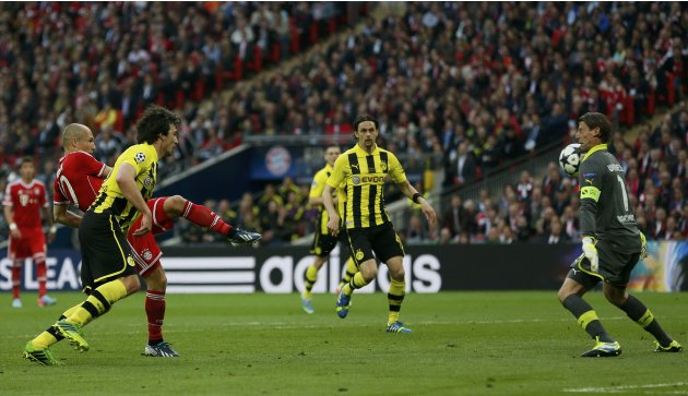 Borussia Dortmund goalkeeper Roman Weidenfeller saves a shot from Bayern Munich's Arjen Robben during their Champions League Final soccer match at Wembley Stadium in London