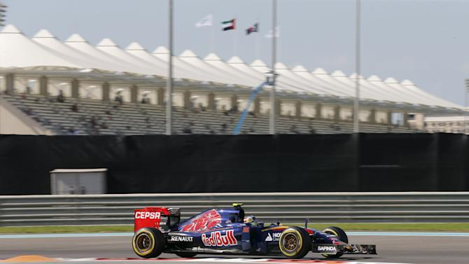 Toro Rosso Formula One driver Carlos Sainz of Spain drives during the first free practice session of Abu Dhabi F1 Grand Prix at the Yas Marina circuit in Abu Dhabi