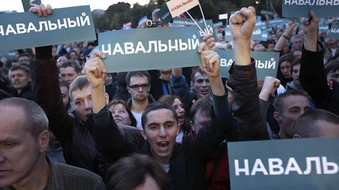 """People hold banners reading """"Navalny"""" during a rally in support of Russian opposition leader Alexei Navalny in Moscow, Russia, Monday, Sept. 9, 2013. Russian opposition leader Alexei Navalny demanded a recount Monday in Moscow's mayoral election after official results showed that the Kremlin-backed incumbent barely escaped facing him in a runoff. Russia's most respected monitoring group also questioned the accuracy of the vote. (AP Photo/Ivan Sekretarev)"""