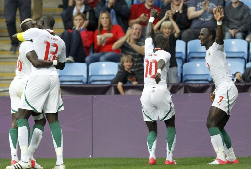 Senegal's Moussa Konate celebrates his goal with teammates during their men's Group A football match against UAE at the London 2012 Olympic Games