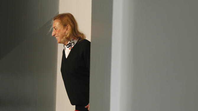 Italian fashion designer Miuccia Prada acknowledges the applause at the end of the Prada men's Spring-Summer 2013 fashion collection, part of the Milan Fashion Week, unveiled in Milan, Italy, Sunday, June 24, 2012. (AP Photo/Luca Bruno)