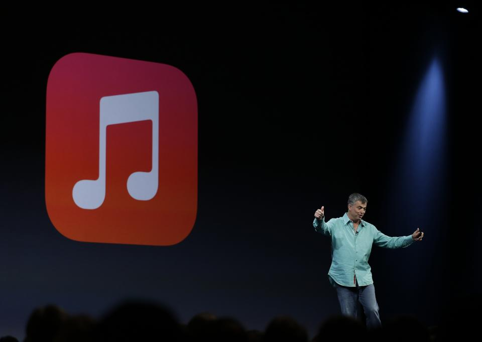 Eddy Cue the Apple senior vice president of Internet Software and Services gestures to applause after demonstrating the new iTunes Radio during the keynote address of the Apple Worldwide Developers Conference Monday, June 10, 2013 in San Francisco. (AP Photo/Eric Risberg)