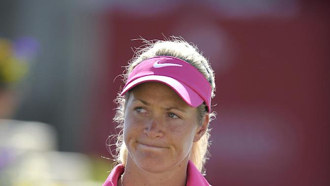 Suzann Pettersen, of Norway, smiles at her fans while they cheer her on after she finished the third round of the LPGA Kraft Nabisco Championship golf tournament in Rancho Mirage, Calif., Saturday, April 6, 2013. (AP Photo/Rodrigo Pena)