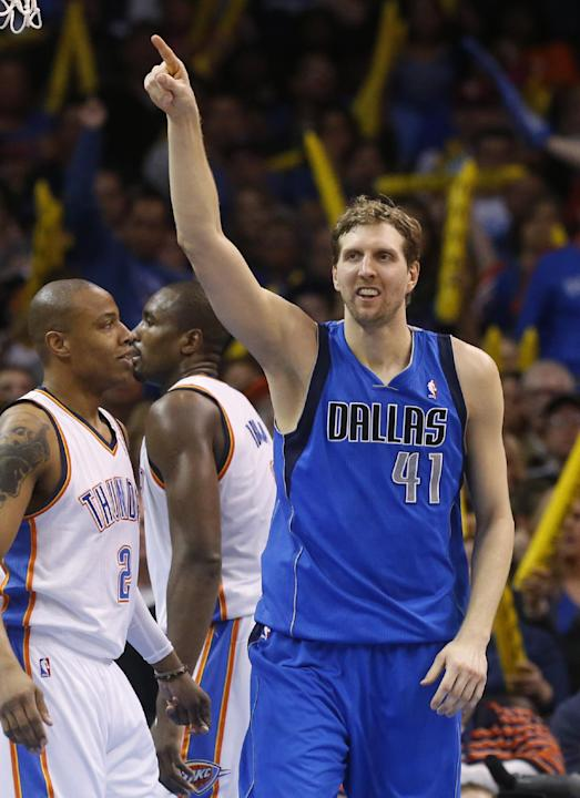Dallas Mavericks forward Dirk Nowitzki (41) reacts following a goaltending call against the Oklahoma City Thunder in the third quarter of an NBA basketball game in Oklahoma City, Sunday, March 16, 201