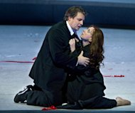 "In this Friday, March 30, 2012 photo provided by the Metropolitan Opera, Matthew Polenzani is Alfredo and Natalie Dessay plays Violetta in a dress rehearsal of Verdi's ""La Traviata,"" at the Metropolitan Opera in New York. (AP Photo/Metropolitan Opera, Marty Sohl)"