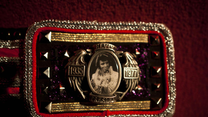 "In this Friday, Sept. 28, 2012 photo, the face of a belt buckle belonging to Argentine Elvis Presley impersonator John McInerny features an image of Presely marked with the years of his birth and death, in Buenos Aires, Argentina. McInerny was chosen to personify the role of Carlos Gutierrez, an Elvis Presley impersonator, in the Argentine film ""The Last Elvis,"" which premiered last April. McInerny put aside his career as an architect to tour the country performing with his band ""Elvis Lives.""  (AP Photo/Natacha Pisarenko)"