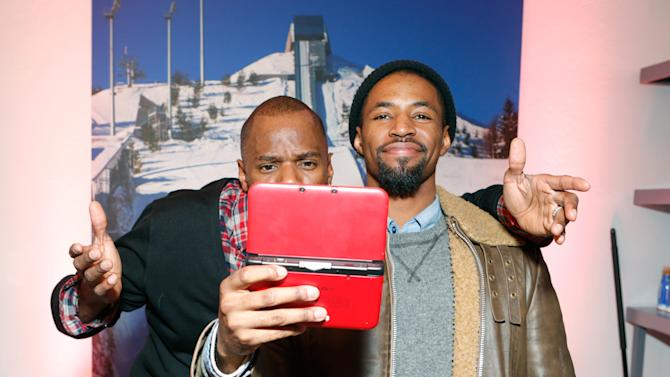 Actors Colman Domingo, left, and Amari Cheetum warm up and check out Nintendo 3DS XL at the Nintendo Lounge during a break from the Sundance Film Festival on Saturday, January 19, 2013 in Park City, UT. (Photo by Todd Williamson/Invision for Nintendo/AP Images)