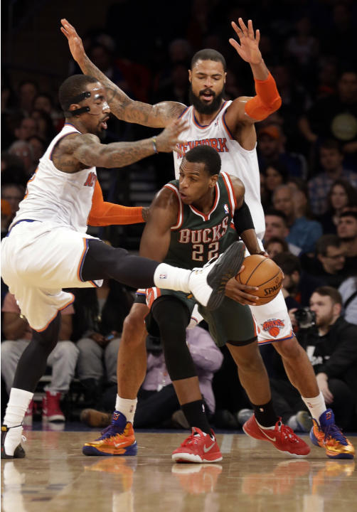 New York Knicks' J.R. Smith, left, and Tyson Chandler box in Milwaukee Bucks' Khris Middleton, center, in the second half of their NBA basketball game at New York's Madison Square Garden,