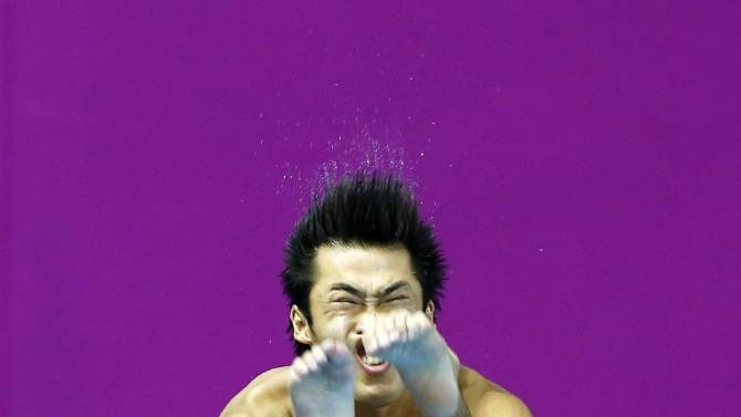 Japan's bronze medallist Sakai competes in the Men's 3m Springboard diving final during the 17th Asian Games in Incheon