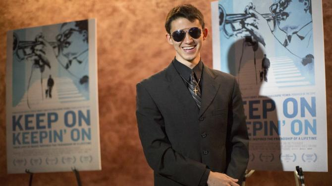 """Pianist and cast member Justin Kauflin poses at the premiere of the documentary """"Keep on Keepin' On"""" at The Landmark theatre in Los Angeles"""