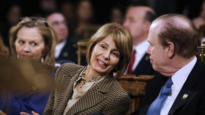 New Jersey state Sen. Barbara Buono, center, D-Edison, talks with Assemblyman Patrick J. Diegnan, D-South Plainfield, as Gov. Chris Christie delivers his State Of The State address Tuesday, Jan. 8, 2013, in Trenton, N.J. Buono has announced that she will challenge the first-term Republican governor in November. (AP Photo/Mel Evans)