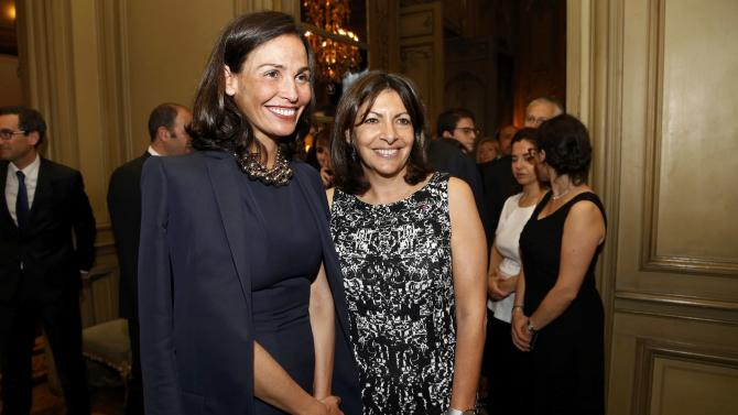 Mayor of Paris Anne Hidalgo poses with Spanish model and actress Ines Sastre as they arrive to attend a reception held by the King and Queen of Spain at the residence of the Spanish ambassador to France in Paris