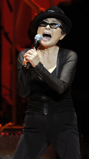 "Yoko Ono performs during the ""Yoko Ono: We Are Plastic Ono Band"" concert at the Orpheum Theater in Los Angeles, Friday, Oct. 1, 2010. (AP Photo/Chris Pizzello)"