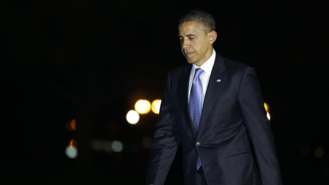 President Barack Obama returns from a trip to Thailand, Myanmar, and Cambodia, on the East Lawn of the White House in Washington on Wednesday, Nov. 21, 2012. (AP Photo/Jacquelyn Martin)
