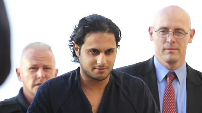 FILE - In this Feb. 25, 2011, file photo, Khalid Ali-M Aldawsari, accused of buying chemicals and equipment to build a weapon of mass destruction, is escorted to a court appearance in Lubbock, Texas. The former student from Saudi Arabia convicted in a failed U.S. bomb plot could be sent to prison for life when he is sentenced Tuesday, Nov. 13, 2012 in in an Amarillo courtroom.  (AP Photo/Lubbock Avalanche-Journal, Zach Long, File)