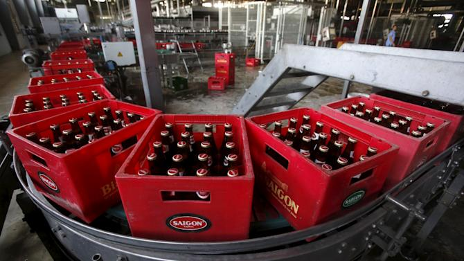 Crates of beer move along a production line of a Sabeco factory in Hanoi, Vietnam