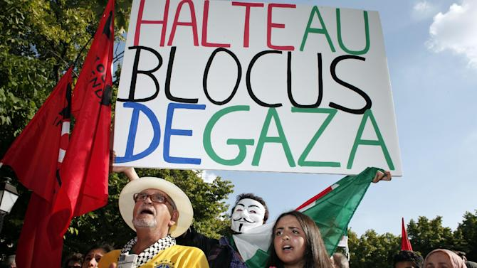 """Pro-Palestinian demonstrators shout anti Israeli slogans during a protest against the Israeli army's bombings in the Gaza strip, in Paris, Wednesday, July 16, 2014. Placard reads: """"Stop the blockade of Gaza"""". (AP Photo/Thibault Camus)"""