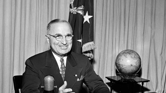 FILE - In this Sept. 1, 1945 file photo, then-U.S. President Harry Truman sits before a microphone at the White House in Washington, where he broadcast a message on the formal surrender of Japan. Clifton Truman Daniel, a grandson of ex-President Truman, who ordered the atomic bombings of Hiroshima and Nagasaki during World War II, is in Hiroshima to attend a memorial service for the victims on Monday, Aug. 6, 2012, marking the 67th anniversary of the atomic bombing. (AP Photo, File)