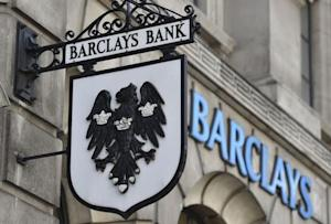 A Barclays sign hangs outside a branch of the bank in the City of London