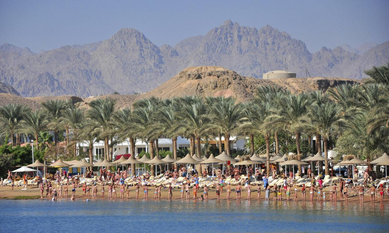 FILE - In this Dec. 6, 2010 file photo, tourists perform their exercises on the sandy beach, at the Egyptian Red Sea resort of Sharm el-Sheikh, Egypt. A much-hyped investment conference opens in Egypt's Red Sea resort of Sharm el-Sheikh Friday, March 13, 2015. Egyptian President Abdel-Fattah el-Sissi the former army chief who overthrew an elected but divisive Islamist president a year and a half ago, has staked his legitimacy on boosting the sagging economy, and his government has set high hopes for the conference. (AP Photo/Hussein Talal, File)