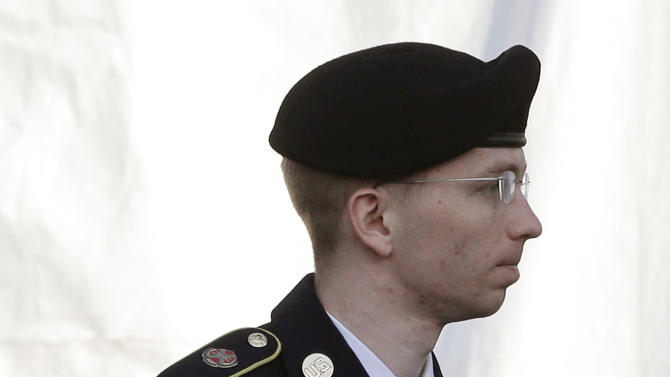 Army Pfc. Bradley Manning is escorted into a courthouse in Fort Meade, Md., Wednesday, April 10, 2013, before a pretrial military hearing. Manning, who is charged with causing hundreds of thousands of classified documents to be published on the secret-sharing website WikiLeaks, is scheduled to face a court martial in June. (AP Photo/Patrick Semansky)