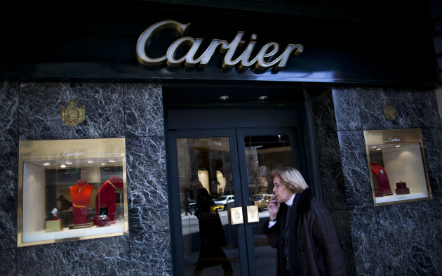 In this Sept. 26, 2012 photo, a woman walks by a Cartier jewelry store along Alvear Avenue in the Recoleta neighborhood in Buenos Aires, Argentina. The world's most luxurious designer brands are abandoning Argentina rather than complying with tight new government economic restrictions, leaving empty shelves and storefronts along the capital's elegant Alvear Avenue, where tourists once flocked to see the latest in fashion. (AP Photo/Natacha Pisarenko)