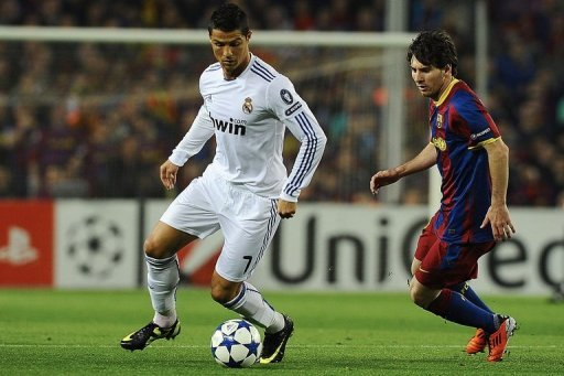 Real Madrid's Portuguese forward Cristiano Ronaldo (L) vies with Barcelona's Argentinian forward Lionel Messi (R)