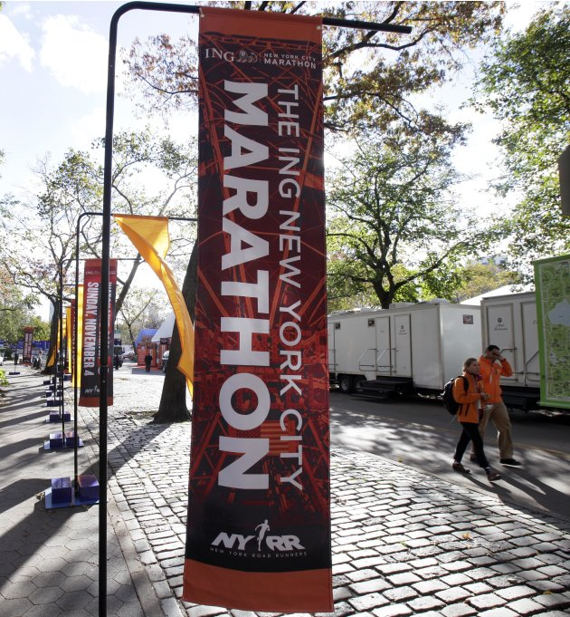 New York City Marathon banners adorn an entrance to New York's Central Park, Friday, Nov. 2, 2012. The course for Sunday's New York City Marathon will be the same since there was little damage but get
