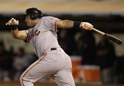 Giants rally past A's 5-4 in 9th, rescue Lincecum