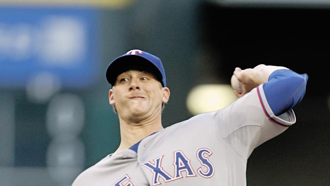 Texas Rangers pitcher Ross Detwiler (47) throws in the first inning against the Houston Astros in a baseball game Monday May 4, 2015, in Houston. (AP Photo/Bob Levey)