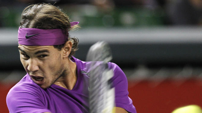 Rafael Nadal of Spain returns the ball to Go Soeda of Japan during the first round match of the Japan Open men's tennis tournament in Tokyo, Tuesday, Oct. 4, 2011. (AP Photo/Koji Sasahara)
