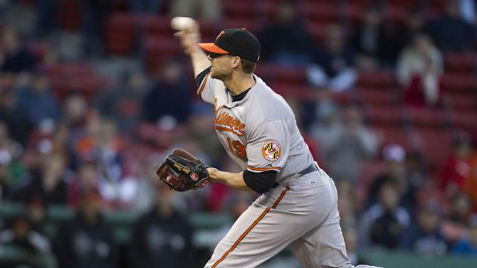Baltimore Orioles' Chris Davis delivers a pitch against Boston Red Sox during the 16th inning of a baseball game at Fenway Park, in Boston on Sunday, May 6, 2012. The Orioles defeated the Red Sox 9-6 in 17 innings. (AP Photo/Steven Senne)