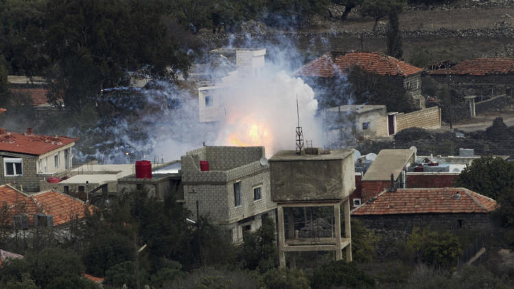 """An explosion after shells fired by the Syrian army hit the Syrian village of Bariqa, Monday, Nov. 12, 2012. The Israeli military says """"Syrian mobile artillery"""" was hit after responding to stray mortar fire from its northern neighbor. The incident marked the second straight day that Israel has responded to fire from Syria that does not appear to be aimed at Israeli targets, nonetheless Israel has promised a tough response if the fire continues. (AP Photo/Ariel Schalit)"""