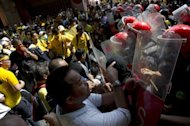 Protestors clash with police during an anti-government rally in Kuala Lumpur on April 28, 2012. Thousands of protesters gathered in the Malaysian capital to demand electoral reform, defying a lockdown of central Kuala Lumpur that left it a maze of razor wire and barricades