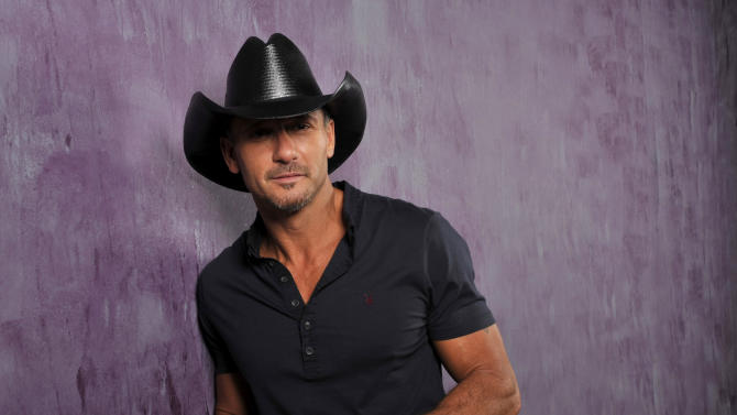 """This Jan. 15, 2013 photo shows country singer and actor Tim McGraw in Nashville, Tenn. His latest album, """"Two Lanes of Freedom,"""" was released on Tuesday, Feb. 5.  The Tennessee Supreme Court has put an end to Curb Records' fight to keep Tim McGraw off another label, two weeks after he released his new album with Big Machine Records. (Photo by Donn Jones/Invision/AP, File)"""